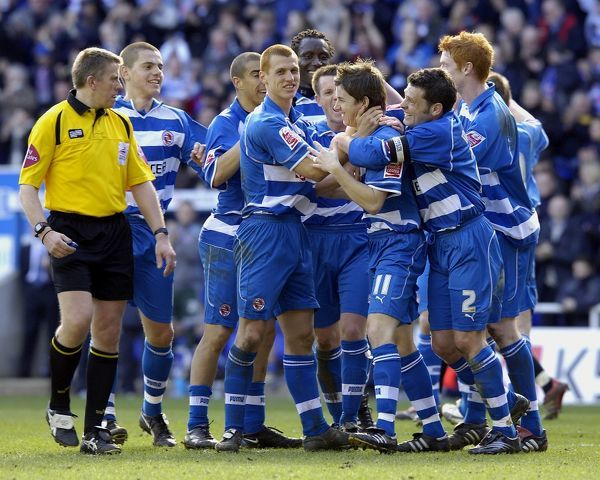 John Oster celebrating his 70th minute goal in Readings 5-0 win over Derby County to win the Championship title