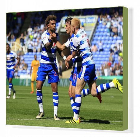 Reading's John Swift (centre) celebrates scoring his side's first goal with Daniel Williams (left) and Paul McShane
