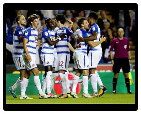 Reading's Modou Barrow (third left) is congratulated by team mates after scoring his side's second goal during the Sky Bet Championship match at the Madjeski Stadium, Reading