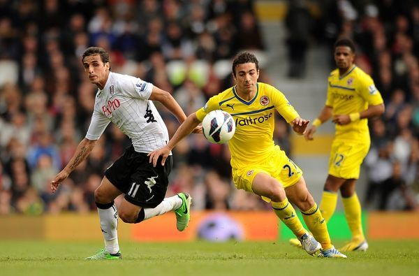 Reading's Stephen Kelly (right) and Fulham's Bryan Ruiz battle for the ball