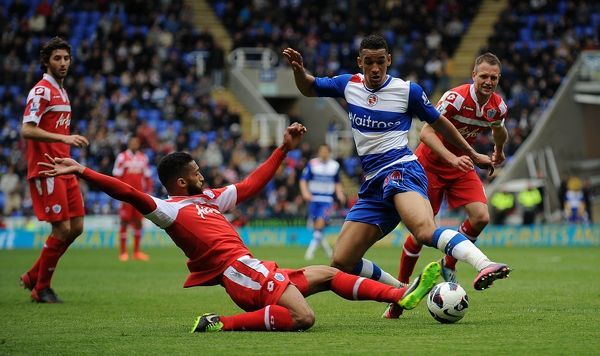 Readings' Nick Blackman (right) is tackled by Queens Park Rangers' Armand Traore (left) during the Barclays Premier League match at the Madejski Stadium, Reading