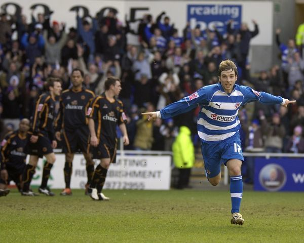 Bobby Convey turns to the crowd after scoring against Wolves, as their beaten defence looks
