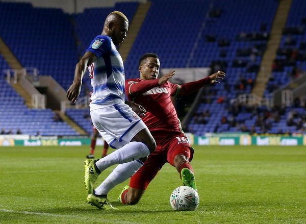 Swansea's Martin Olsson tackles Reading's Leandro Bacuna during the Carabao Cup, third round match at the Madejski Stadium, Reading
