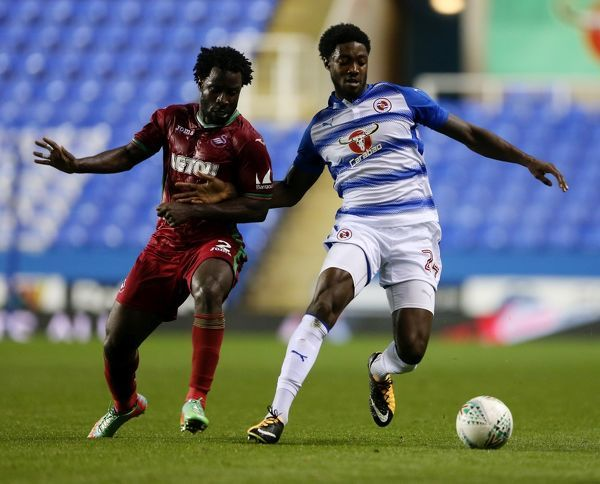 Reading's Tyler Blackett in action with Swansea's Wilfried Bony (left) during the Carabao Cup, third round match at the Madejski Stadium, Reading