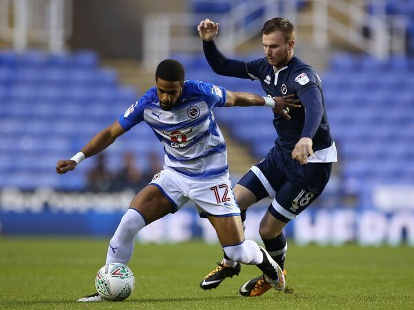 Reading Garath McCleary (left) and Millwall Ryan Tunnicliffe in action