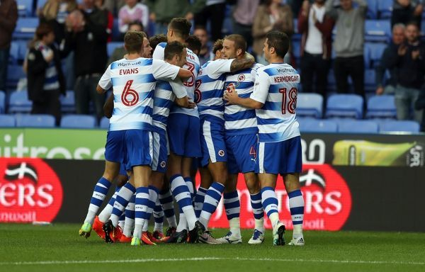 Reading's Joey van den Berg (2nd right) celebrates with his team mates after he heads home the opening goal of the game during the first round match of the EFL Cup at the Madejski Stadium, Reading