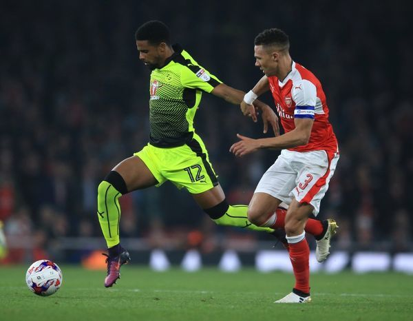 Arsenal's Kieran Gibbs (right) and Reading's Garath McCleary battle for the ball