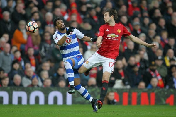Manchester United's Daley Blind (left) and Reading's Garath McCleary battle for the ball