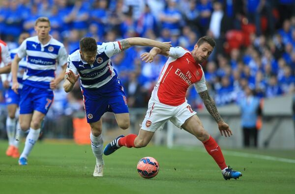 Reading's Jamie Mackie, (left) battles for possession of the ball with Arsenal's Mathieu Debuchy, (right)