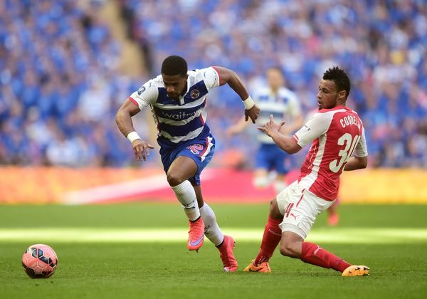 Reading's Garath McCleary battle for the ball with Arsenal's Francis Coquelin during the FA Cup Semi Final match at Wembley Stadium, London. PRESS ASSOCIATION Photo. Picture date: Saturday April 18, 2015. See PA story SOCCER Reading