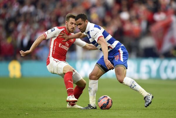 Reading's Hal Robson-Kanu (right) and Arsenal's Aaron Ramsey battle for the ball during the FA Cup Semi Final match at Wembley Stadium, London. PRESS ASSOCIATION Photo. Picture date: Saturday April 18, 2015. See PA story SOCCER Reading