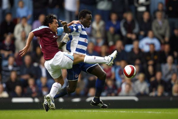 Ibrahima Sonko holds of Carlos Tevez during the Barclays Premiership match between West Ham United and Reading FC at Upton Park on October 1, 2006 in London, England. (Photo by Richard Claypole)