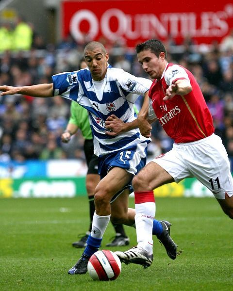 James Harper and Robin Van Persie battle for possession in Reading's 4-0 defeat by Arsenal