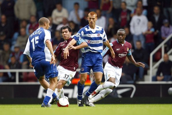 James Harper& Steve Sidwell battle with Carlos Tevez & Nigel Reo-Coker during the Barclays Premiership match between West Ham United and Reading FC at Upton Park on October 1, 2006 in London, England. (Photo by Richard Claypole)