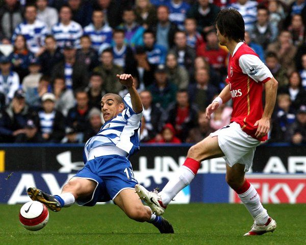 James Harper beats Tomas Rosicky to the ball