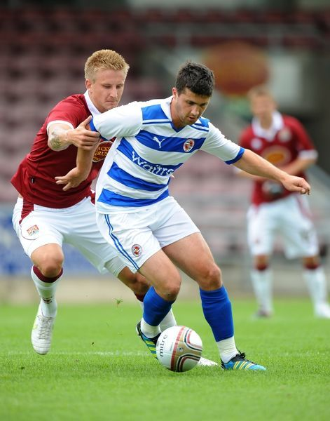 Northampton Town's Byron Webster and Reading's Shane Long