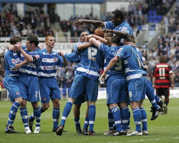 Reading players run to join Dave Kitson celebrating his goal against Queens Park Rangers in the last game of the season