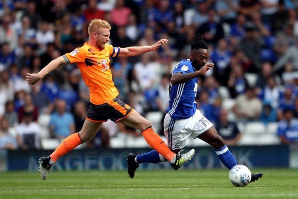 Birmingham City's Jacques Maghoma (right) and Reading's Paul McShane battle for the ball