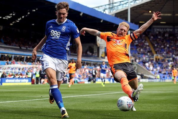 Birmingham City's Sam Gallagher (left) and Reading's Paul McShane battle for the ball