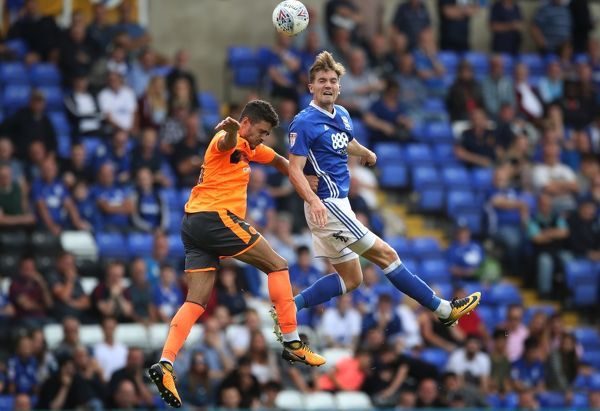 Birmingham City's Sam Gallagher battles to win header beating Reading's Thiago Ilori
