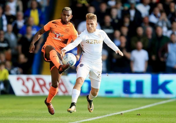 Reading's Leandro Bacuna and Leeds United's Samuel Saiz battle for the ball during the Sky Bet Championship match at Elland Road, Leeds