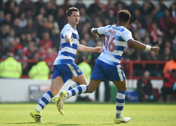 Reading's Yann Kermorgant (left) celebrates scoring his second goal of the game