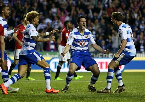 Reading's Yann Kermorgant celebrates scoring his side's first goal of the game from the penalty spot