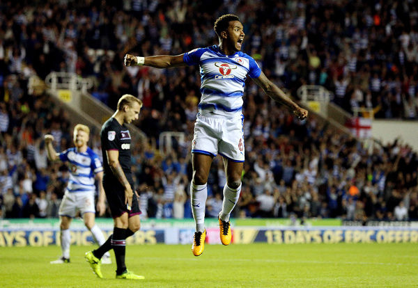 Reading's Liam Moore jumps in celebration after Modou Barrow (not pictured) scores his side's second goal during the Sky Bet Championship match at the Madjeski Stadium, Reading