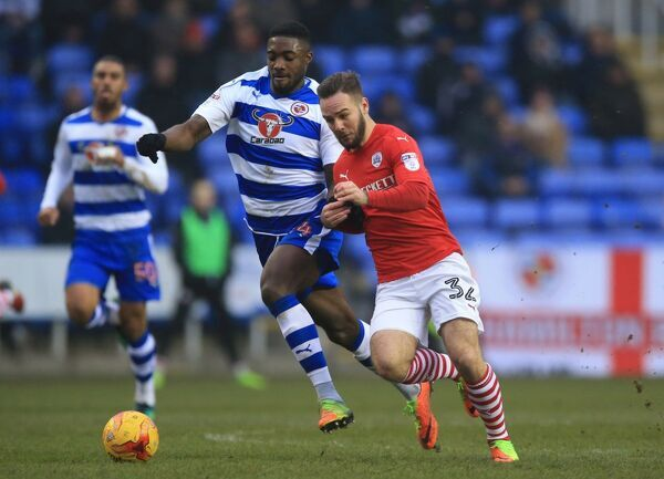 Reading's Tyler Blackett (left) and Barnsley's Adam Armstrong battle for the ball