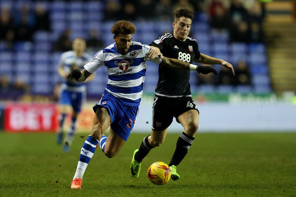 Reading's Danny Williams (left) is challenged by Brentford's Sergi Canos during the Sky Bet Championship match at the Madejski Stadium, Reading