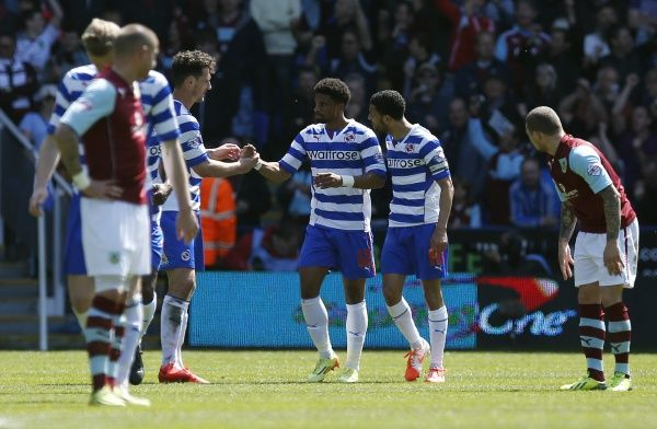 Reading's Garath McCleary (centre) is congratulated by team mates Sean Morrison (centre left) and Jobi McAnuff (centre right) after scoring the equalising goal