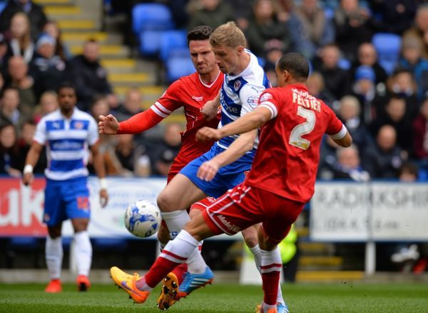 Reading's Pavel Pogrebnyak tackled by Cardiff City's Lee Peltier