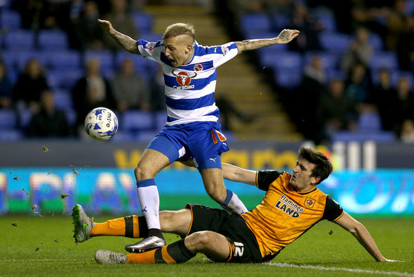 Reading's Deniss Rakels (left) and Hull City's Harry Maguire battle for the ball