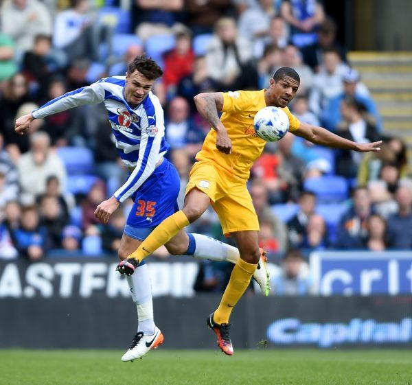 Reading's Jake Cooper (left) and Preston North End's Jermaine Beckford battle for the ball