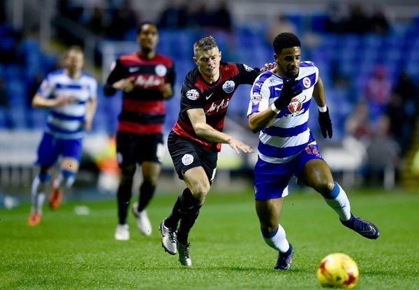 Queens Park Rangers' Paul Konchesky and Reading's Garath McCleary battle for the ball