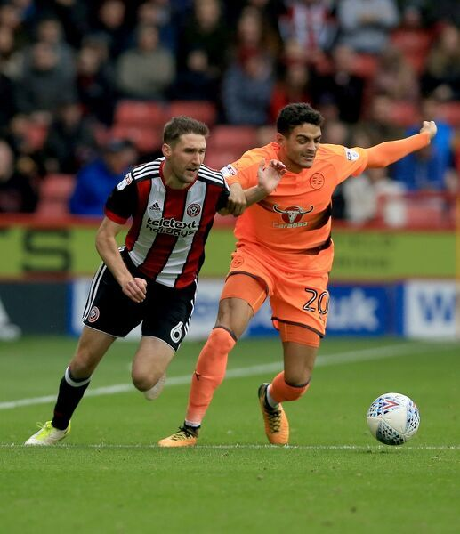 Sheffield United's Chris Basham (Left) and Reading's Tiago Llori battle for the ball
