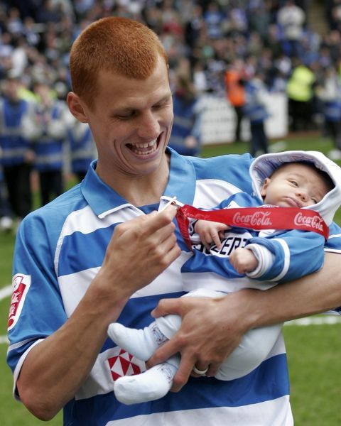 Steve Sidwell shows his baby son his new medal