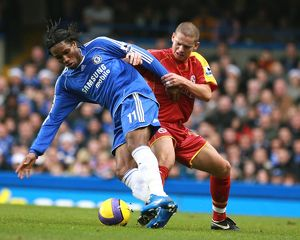 Ivar Ingimarsson stays close to Chelsea's top goal scorer Didier Drogba.