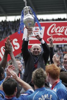 Steve Coppell lifts the trophy
